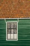 Ancient traditional old fashioned wood window and tile roof in Amsterdam, The Netherlands