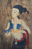 Ancient Traditional painting of woman with costume on wooden brown backgrounds, thai style standing female drawing on wood Royalty Free Stock Photos