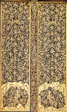 Ancient Traditional Thai Style Painting on the Doo. R in Gold Color Stock Image