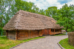 Ancient traditional ukrainian rural cottage with a straw roof Stock Images