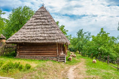 Ancient traditional ukrainian rural cottage with a straw roof Royalty Free Stock Image