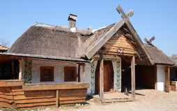 Ancient traditional Ukrainian wooden rural cottage with a straw roof, Khortytsia island, Ukraine Stock Photography