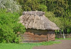 Ancient wicker barn with a straw roof Stock Image