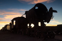 Ancient train cemetery at sunset Royalty Free Stock Photo