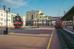 Ancient train of a ng of the station square. Royalty Free Stock Photo