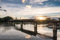 Ancient train running on bridge in River Kwai landmark of Kancha. Naburi, Thailand Royalty Free Stock Photos