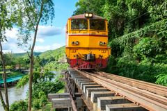 Ancient train running on wooden railway in Tham Krasae. Kanchanaburi, Thailand Royalty Free Stock Photos