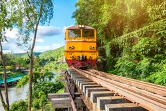Ancient train running on wooden railway in Tham Krasae. Kanchanaburi, Thailand Stock Images