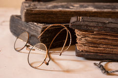 Ancient Treatise with very old glasses Royalty Free Stock Images