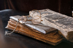 Ancient Treatise with very old glasses Stock Photography