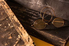 Ancient Treatise with very old glasses Royalty Free Stock Photos