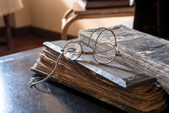 Ancient Treatise with very old glasses Stock Images