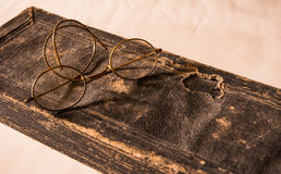 Ancient Treatise with very old glasses Royalty Free Stock Photography