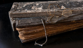 Ancient Treatise with very old glasses Stock Image