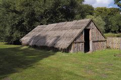 Ancient tribal dwelling. Modern reconstruction of thatched dwelling of Iceni tribe from East Anglia region of Britain stock photography