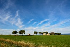 Ancient trulli, countryside, sea and clouds in Puglia. An Ancient trulli, countryside, sea and clouds in Puglia Royalty Free Stock Photo