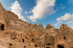 Ancient tuff stone cave village with church. In Goreme Cappadocia Turkey Stock Photo