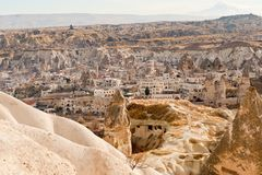 Ancient tuff stone caves and Goreme city view. Ancient tuff stone caves landscape and Goreme city view cappadocia Turkey Royalty Free Stock Photo