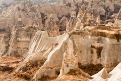 Ancient tuff stone caves landscape in Cappadocia. Ancient tuff stone caves landscape in Goreme Cappadocia Turkey Stock Photo