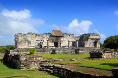 Ancient Tulum Mayan ruins Mexico Quintana Roo. Ancient Tulum Mayan temple ruins in Mexico Quintana Roo under blue sky Royalty Free Stock Image