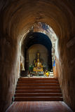 The ancient tunnel and statue buddha Royalty Free Stock Images