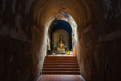 The ancient tunnel and statue buddha Royalty Free Stock Photos