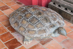 Ancient Turtle Carving Stone Statue Aged Over 100 Years, Important Animal in Buddhism.  Stock Photos