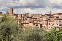 Ancient Tuscany Skyline. Panoramic view of an ancient Tuscan village in Italy Stock Image
