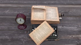Ancient typewriter and old Bible book on wooden background stock video footage