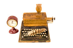 Ancient typewriter with old book and clock isolated Stock Image