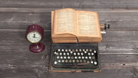 Ancient typewriter and old book. Wind in book page Stock Image