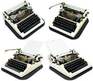 Ancient typewriters on a white. Four ancient typewriters on a white background royalty free stock images