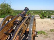 Ancient ukrainian cannon. Against ukrainian landscape on background stock photos