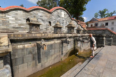 Ancient Unesco heritage architecture in Pashupatinath, now damag Stock Image