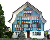 Ancient unique colourful house in historic medieval old town. Appenzell is well-known for its colourful houses with painted facade Stock Image