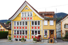 Ancient unique colourful house in historic medieval old town. Appenzell is well-known for its colourful houses with painted facade Stock Photos