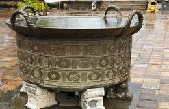 Ancient Urn in Hue. An ancient urn in the citadel of Hue, Vietnam filled with rain water on a rainy day Royalty Free Stock Images