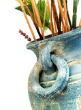 Ancient vase. A close-up view of an ancient vase on a white background stock photo