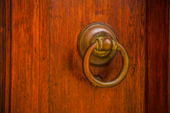 Ancient Venetian door with old door knob close-up Stock Images