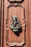 Ancient Venetian door with old door knob close-up Royalty Free Stock Images