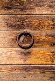 Ancient Venetian door with old door knob close-up Stock Photos