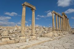 Ancient vertical columns with capital in Je Stock Photography