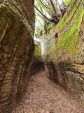 Via Cava, an ancient Etruscan road carved through tufo cliffs in Tuscany. An ancient via cava created by the Etruscans in the countryside of Tuscany near an royalty free stock image