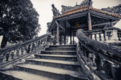 Ancient vietnamese temple with dragons on top Stock Image