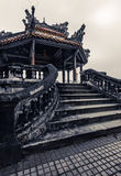 Ancient vietnamese temple with dragons on top Royalty Free Stock Image
