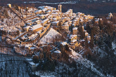 Ancient village in the mountains. Last rays of the sun of the old town in the mountains stock image