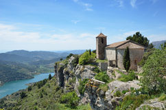 Ancient village Siurana on the green steep slope Stock Photography