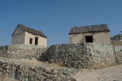 Ancient village street view with two small huts and crossroads Stock Image