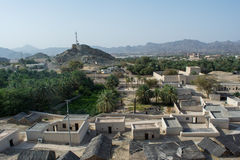 Ancient village view with houses and palm trees from top of the hill Royalty Free Stock Photos