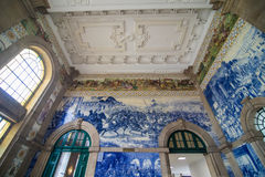 Porto, Portugal - July 2017. Ancient vintage azulejos picture in the old Sao Bento Railway Station of Porto. Building of Sao Bento. Ancient vintage azulejos Stock Photography